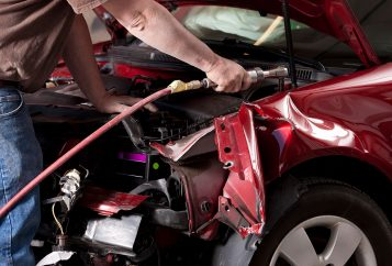 Auto Body Mechanic Disassembling Damaged Vehicle