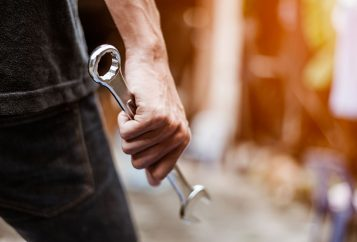 Man holding a wrench