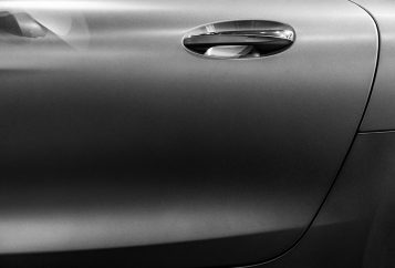 Black and white car door with handle